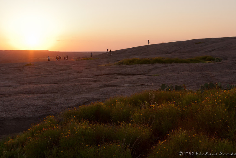 People hike down Enchanted Rock at sunset, Enchanted Rock State Park, Tx