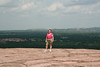 Jan, standing at the top of the world.  Well almost, at the top of the Enchanted Rock dome.<br /> Enchanted Rock State Park, Fredericksburg, Texas