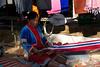 Tribal villager weaving scarf like a flag