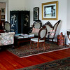 Living room with persian rugs on douglas fir floors.