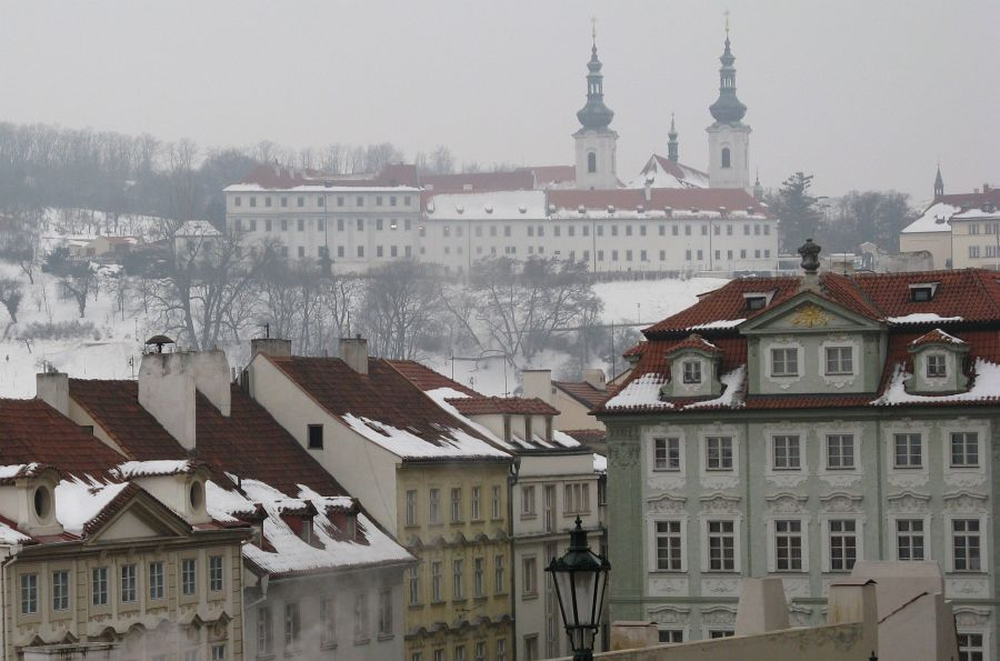 Snowy rooftops of Malá Strana and the Premonstraterian Monastery at Strahov in the background