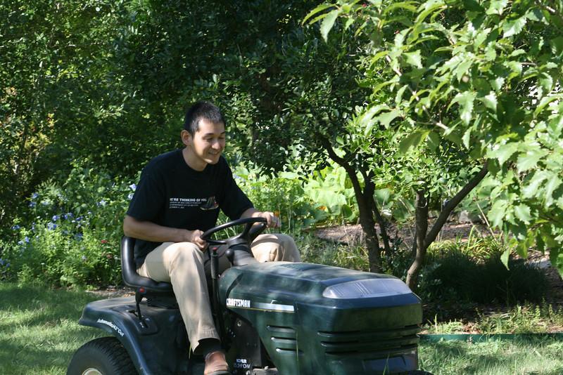 Dr Somura mows his first yard!