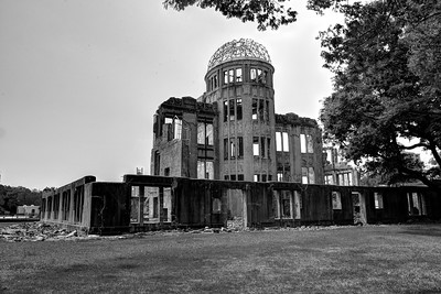 The A-Bomb Dome is the skeletal ruins of the former Industrial Promotion Hall. It is the building closest to the hypocenter of the nuclear bomb that remained at least partially standing. It was left how it was after the bombing in memory of the casualties. The A-Bomb Dome, to which a sense of sacredness and transcendence has been attributed, is situated in a distant ceremonial view that is visible from the Peace Memorial Park's central cenotaph. It is an officially designated site of memory for the nation's and humanity's collectively shared heritage of catastrophe. The A-Bomb Dome is on the UNESCO World Heritage List.  Hiroshima (広島市) is the capital of Hiroshima Prefecture, and the largest city in the Chūgoku region of western Honshu, which is the largest island of Japan. It is recongnized as the first city in history to be targeted by a nuclear weapon when the United States Army Air Forces (USAAF) dropped an atomic bomb on it at 8:15 a.m. on August 6, 1945, near the end of World War II. Hiroshima is situated on the Ōta River delta, on Hiroshima Bay, facing the Seto Inland Sea on its south side. The river's six channels divide Hiroshima into several islets.