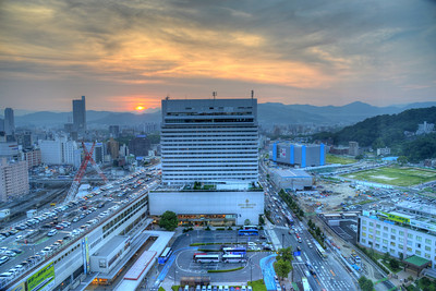 View from our room in Sheraton Hotel, Hiroshima, Japan.  Hiroshima (広島市) is the capital of Hiroshima Prefecture, and the largest city in the Chūgoku region of western Honshu, which is the largest island of Japan. It is recongnized as the first city in history to be targeted by a nuclear weapon when the United States Army Air Forces (USAAF) dropped an atomic bomb on it at 8:15 a.m. on August 6, 1945, near the end of World War II. Hiroshima is situated on the Ōta River delta, on Hiroshima Bay, facing the Seto Inland Sea on its south side. The river's six channels divide Hiroshima into several islets.