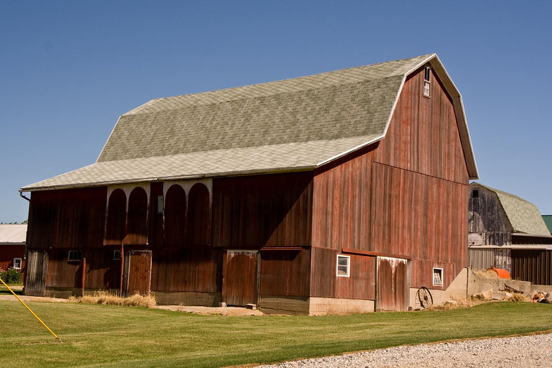 This first barn is a good example of the southeast Michigan gambrel-roof barn. It's features include red paint with white painted arches and a full-length shed addition. It is in Bridgewater Township.
