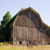 Many of the gable roofed barns were converted to this gambrel-roof for more storage capacity.