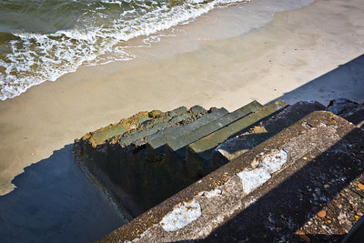 Old concrete steps, once used to reach the beach at Fort Monroe.  With the erosion of the beach, the stairs are often submerged at high tide and have long since been blocked from use.