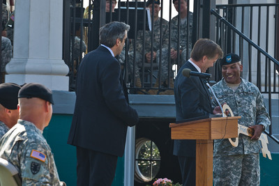 Colonel Reyes presents the ceremonial key to Fort Monroe to Governor Bob McDonnell as Glenn Oder, Executive Director of the Fort Monroe Authority looks on.