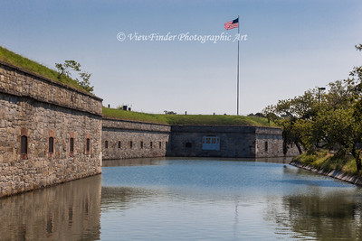 A view of the Flag Bastion atop the moat wall/earthworks.  The white windows were once part of an officers club during the 19th and early 20th century.