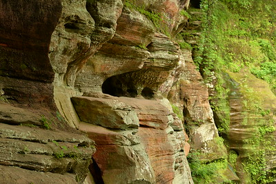 Rock formations on the side of the pathway to Rock House - Hocking Hills State Park