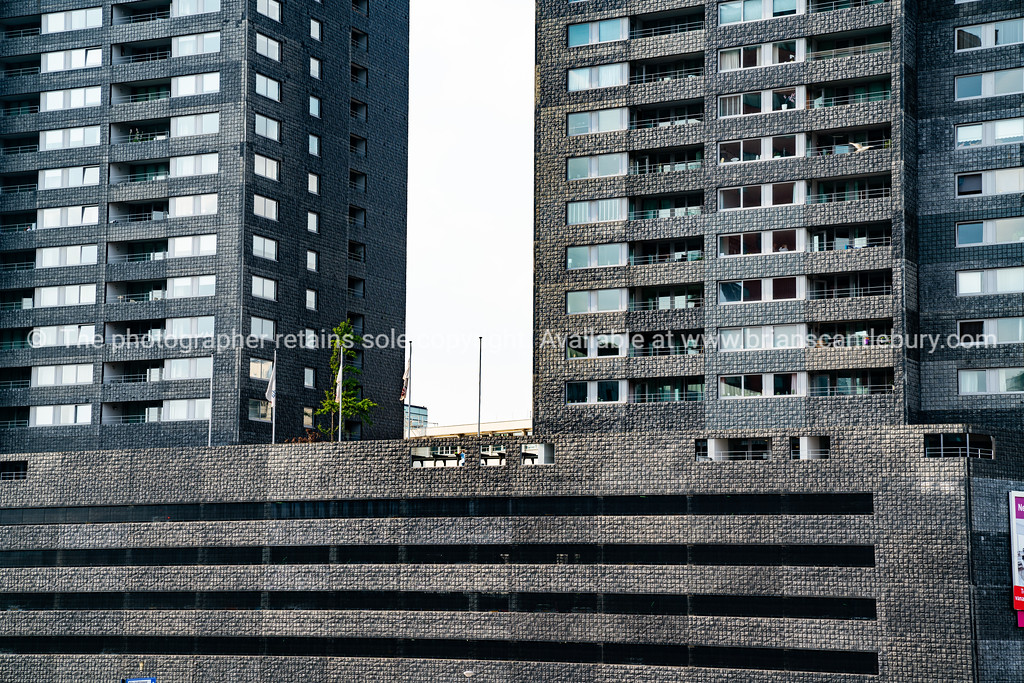 Two tower stark in concrete and glass apartment