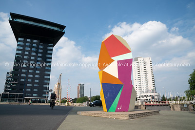 Multi-colored sculpture cubic sculpture in Erasmuburg district with city's stunning modern architectural
