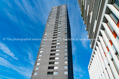 Tower apartments rising high into sky from low point of view