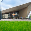 Modernist Rotterdam Centraal Railway Station with people around entrance