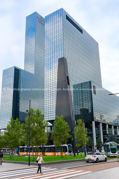 sharp edges of glass exterior of modern office building.