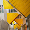 Cube houses are a set of bright yellow angled apartments