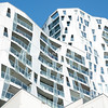 Quirky fantastical design white Calypso tower high rise office and apartment residential building