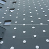 Low angle view modern architectural tower black extrior with white dots