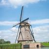 Scenic Kinderdijk area of ponds, fields and windmills.