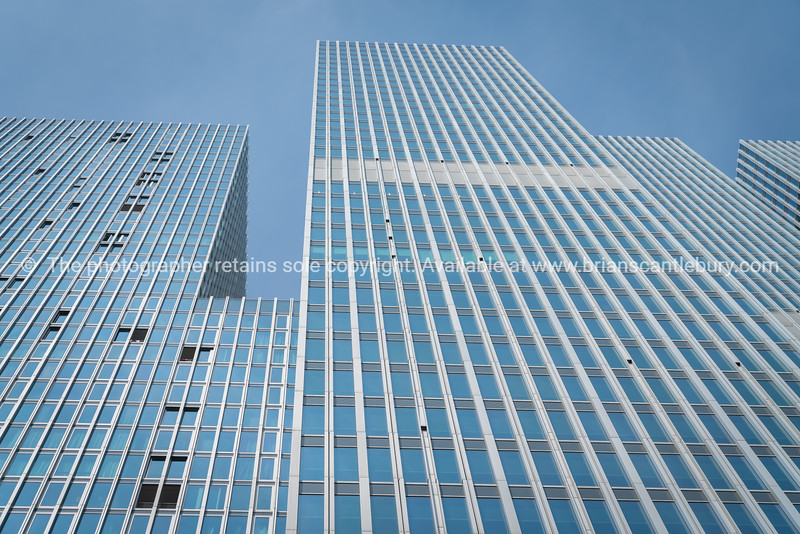 Blue toned facade of city high-rise office block