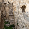 """Pools of Bethesda<br /> <br /> The remains of the Pools of Bethesda were discovered by the White Fathers while excavating the grounds of St. Anne's church.  The largest pool is 350 feet long, 200 feet wide, and 40 feet deep.<br /> <br /> """"Now there is in Jerusalem at the Sheep Gate a pool called  in Hebrew Bethesda, with five porticoes.  In these lay a large number of ill, blind and crippled.""""  John 5: 2-3"""