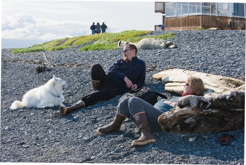 "Nisa, Michael and Susanna Sharp  in front of ""Lands End restaurant""  at the end of the Homer  Spit, Homer Alaska.  NIsa is listening to her Alpha tell her a story."