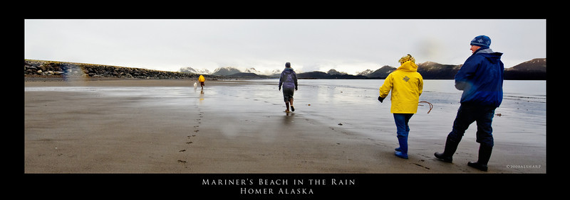 "Mariner's Beach In the Rain, Homer Spit, Homer Alaska.  ""low tide"" on a rainy day walkabout.  rubber boots are the standard footwear in Homer.  You can tell tourists by the newness of their shiny inexpensive boots."