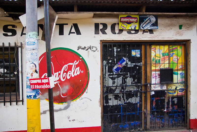 The little stores are everywhere. So are the Coke signs.