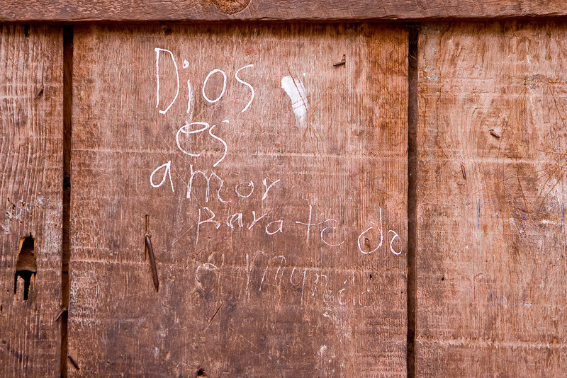 This is a detail of Maria's door: Dios es amor para todo el mundo (and I need to verify the proper spelling). God is love for the whole world.