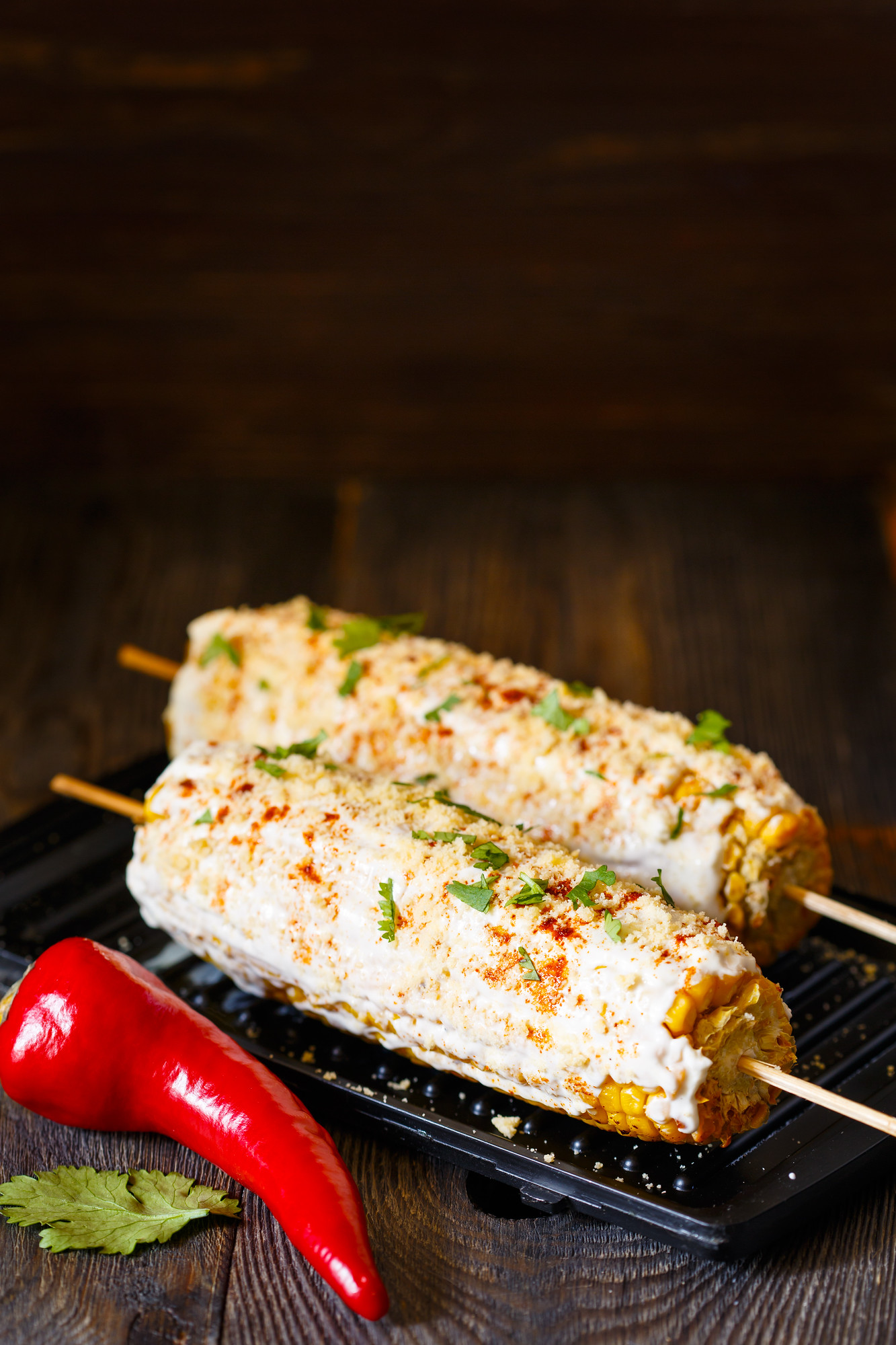 Elote is a popular Honduran food, which is corn on the cob with mayonnaise and sometimes cheese.