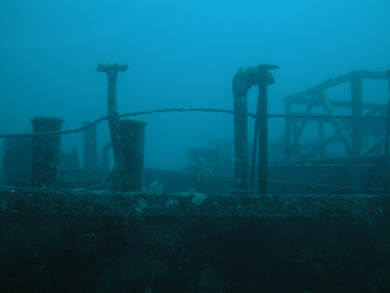 A picture of a ship wreck taken from a submarine.