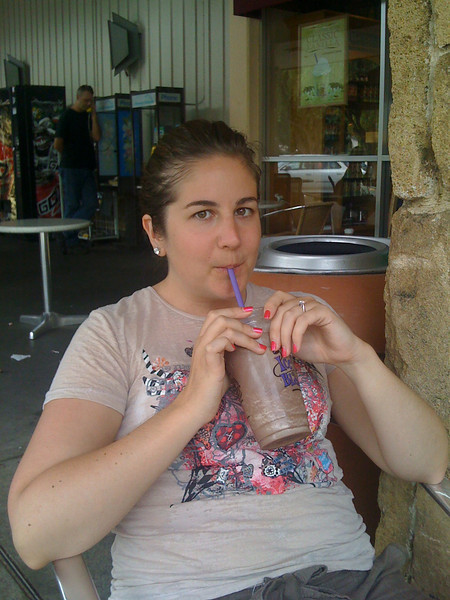 Jeannette enjoys a well-deserved blended ice mocha after our hike up to Manoa Falls.