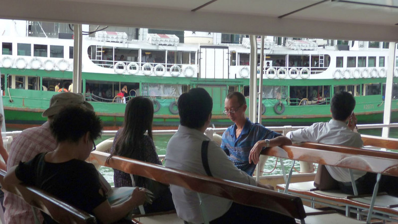 Passengers on the open midships section of Solar Star' upper deck