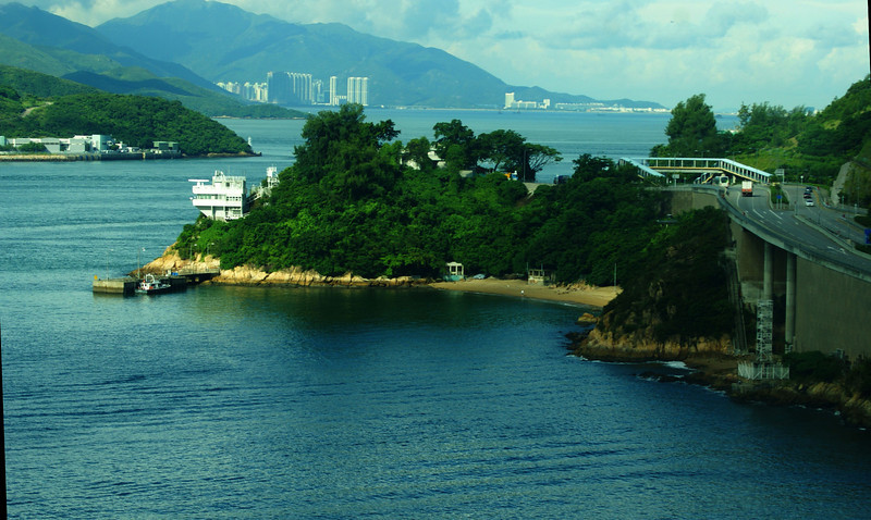 Pat of the Hong King International Airport can be seen in the far distance on the right - it is on Lantau Island opposite Tuen Mun and the Castle Peak. The white building above the beach on the near promontary houses an exhibition of all of the infrastructure projects that were undertaken in connection with the creation of the airport. The airport opened in 1997, a few weeks before control of Hong Kong reverted to China - it replaced the famous Kai Tak airport in Kowloon.