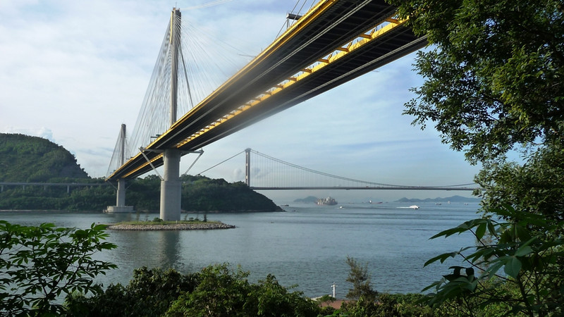 "Tsing Ma Bridge  <a href=""http://upload.wikimedia.org/wikipedia/commons/1/1d/Tsing_Ma_Bridge_2008.jpg"">http://upload.wikimedia.org/wikipedia/commons/1/1d/Tsing_Ma_Bridge_2008.jpg</a>) on the right and Ting Kau Bridge  <a href=""http://en.wikipedia.org/wiki/Ting_Kau_Bridge"">http://en.wikipedia.org/wiki/Ting_Kau_Bridge</a>) in the middle - the latter connects Tsing Yi island to Tuen Mun Road in the New Territories. Ting Kau is the world's largest 4 span cable stay bridge. The central and largest tower is stabilised longitudinally by special stays that can be seen in the picture at following link<br /> <br />  <a href=""http://upload.wikimedia.org/wikipedia/commons/e/e0/Ting_Kau_Bridge_0604.JPG"">http://upload.wikimedia.org/wikipedia/commons/e/e0/Ting_Kau_Bridge_0604.JPG</a>"