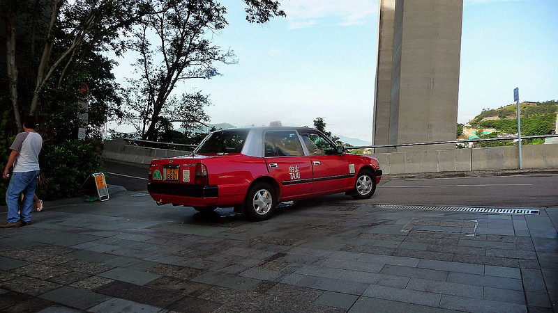 A Hong Kong red taxi at the Royal View. In Hong Kong red taxicabs work in Kowloon and Hong Kong  Island, green cabs work in the New Territories and blue cabs work on Lantau Island around the airport