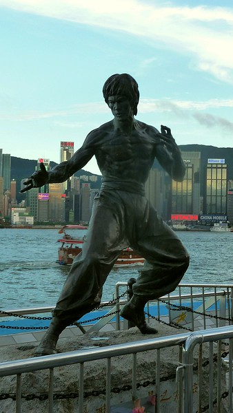Statue of the Chinese martial arts film star Bruce Lee on the harbourside at Tsim Sha Tsui