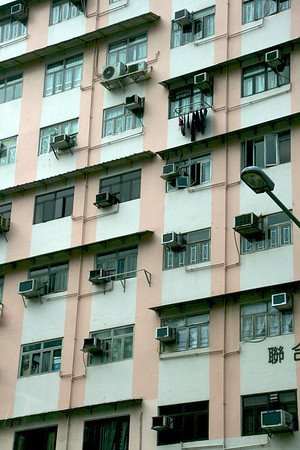 This picture, and the next 2, is typical apartment building in Hong Kong. Notice that people hang their laundry on hooks right outside of the windows.
