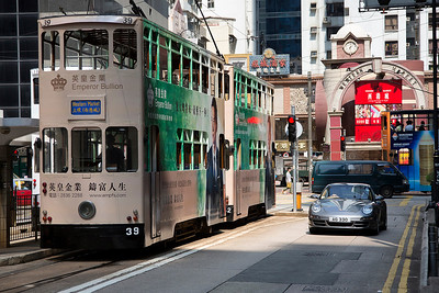 Sheung Wan district on HK island with traditional buses and nowadays....fancy cars