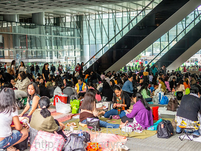 Hong Kong. Domestic workers enjoy public spaces on their day off.