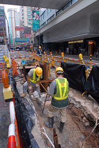 Construction crew working on the streets of Hong Kong.