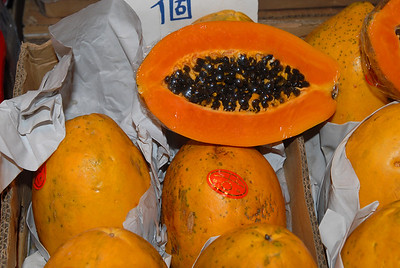 Fresh papaya for dessert, for sale at a sidewalk food vendor.