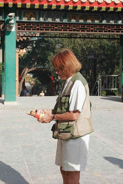 When in Rome, er, Hong Kong...Jan tries her luck with Joss sticks.