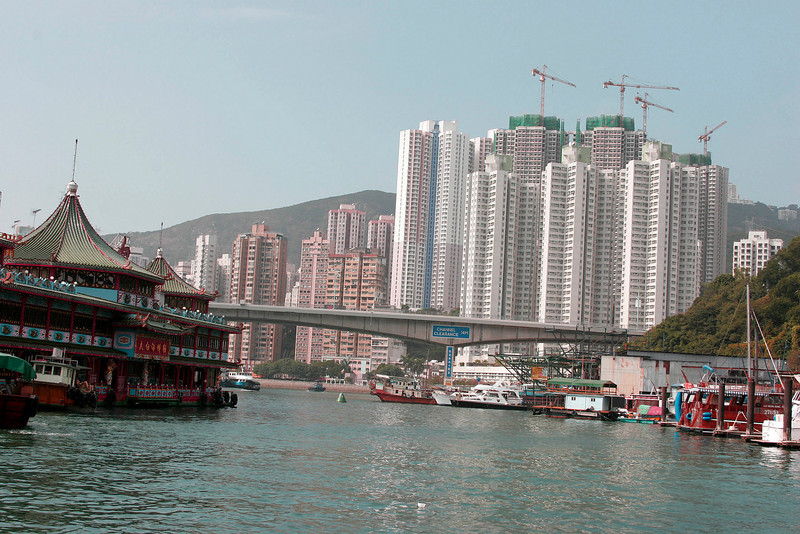 Floating restaurant, left, one of two remaining, in Hong Kong Harbor. Construction cranes are everywhere.