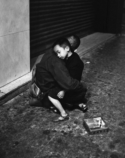 """This shot, taken on the cold night streets of Hong Kong, I call """"The Empty Can.""""  I take the photograph and place pocket offal in the empty can. I walk off quietly, and suddenly miss home and family."""