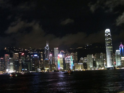 "Hong Kong Island skyline at night. Behind Victoria Peak (""The Peak""), on the right the park and viewing areas, to the left the upscale residential areas."