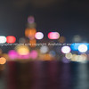 Hong Kong's Victoria Harbor and commericial Island illuminated in and abstract urban image of city night lights.