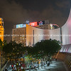 Spectacular lights shining on large curving Cultural Center facade