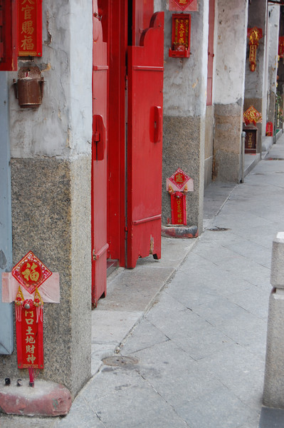 Little shrines at each doorway in Macau