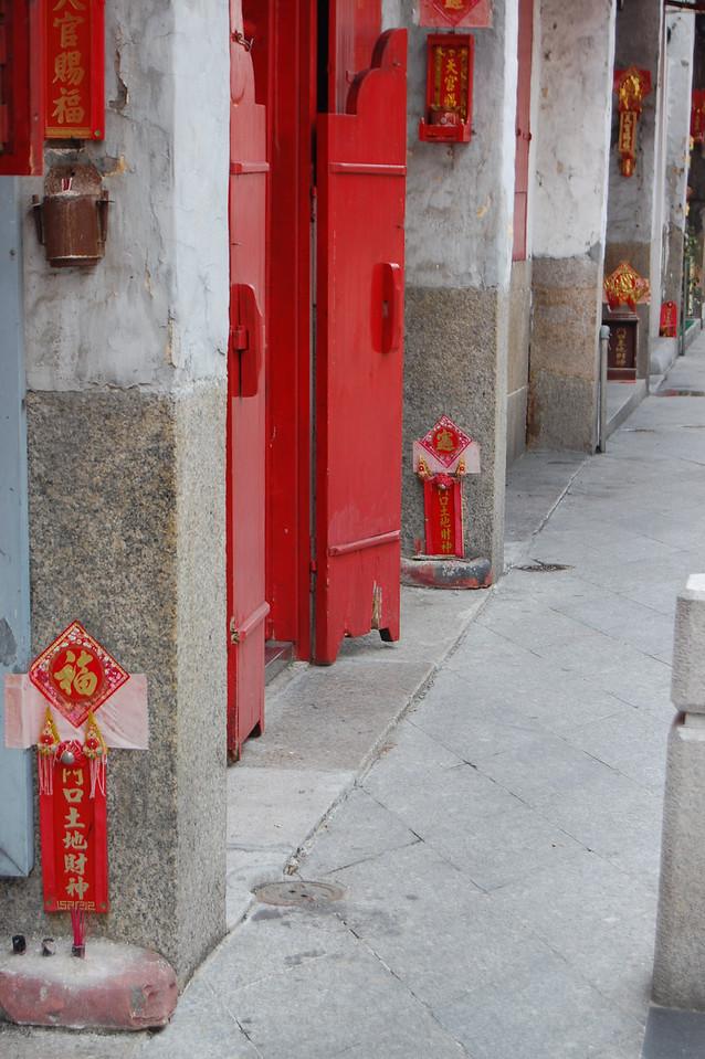 Little shrines at each doorway in Macau